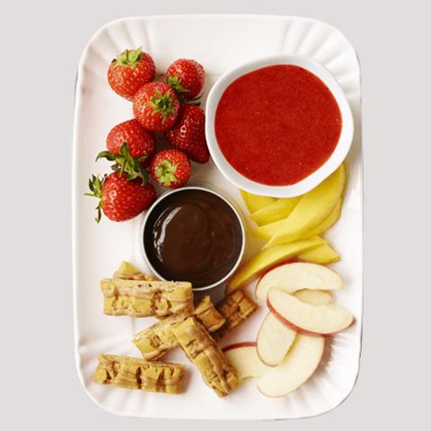 A sharing plate of fruit fondue.